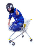 Motorcyclist in shopping cart, thumb up Royalty Free Stock Photography