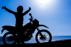 Motorcyclist silhouette & adventurous motorcyclist Stock Photography