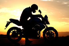 Motorcyclist Silhouette At The Sunset Stock Images