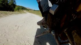 Motorcyclist sits on a bike stock footage