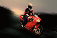 Motorcyclist on a sport bike. In motion Royalty Free Stock Photo