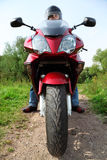 Motorcyclist standing on country road, closeup royalty free stock image