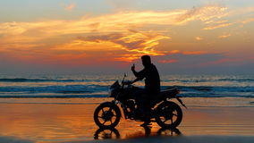Motorcyclist at sunset Royalty Free Stock Image