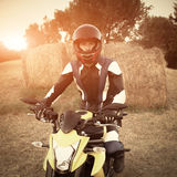 Motorcyclist at sunset Royalty Free Stock Images