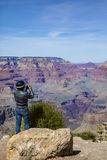 Motorcyclist Taking Pictures Of The Grand Canyon Royalty Free Stock Images