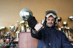 Motorcyclist with trophy Stock Images