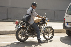 Motorcyclist waiting Havana Stock Photography