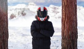 Motorcyclist in a warm winter jacket in the winter forest stock images