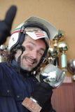 Motorcyclist winking at camera Stock Photo