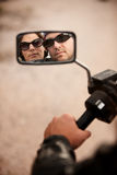 Motorcyclist and Woman Reflection Royalty Free Stock Photos