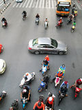 Motorcyclists and cars wait at a junction during rush hour royalty free stock photo