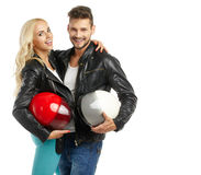 Motorcyclists couple with helmets Royalty Free Stock Photos