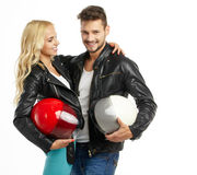 Motorcyclists couple with helmets Royalty Free Stock Image