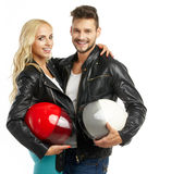 Motorcyclists couple with helmets Royalty Free Stock Photography