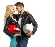 Motorcyclists couple with helmets Stock Photos