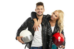 Motorcyclists couple with helmets in hand Stock Photo