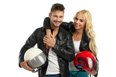 Motorcyclists couple with helmets in hand Royalty Free Stock Photo