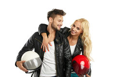 Motorcyclists couple with helmets in hand Stock Photography