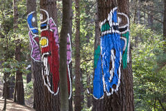 Motorcyclists in the forest. Motorcyclists painted on trunks in the Oma forest, by Agustin Ibarrola, in the Basque Country, Spain Stock Image