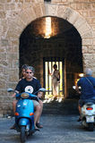 Motorcyclists at the gates of ancient Rhodes city. Rhodes island, Greece, 29/06/2014 Royalty Free Stock Photos