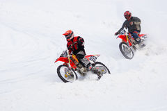 Motorcyclists go on ice in snow. Stock Images