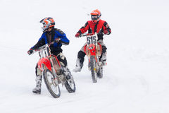 Motorcyclists go on ice in snow. Stock Photo