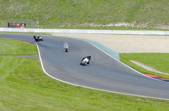 Motorcyclists on the highway in steep bend Royalty Free Stock Photos