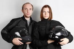 Motorcyclists man and woman in studio stock photo