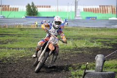 Motorcyclists on motorcycles participate in cross-country race. Royalty Free Stock Images