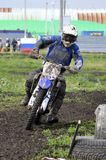 Motorcyclists on motorcycles participate in cross-country race. Stock Images