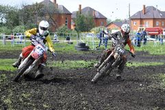 Motorcyclists on motorcycles participate in cross-country race. Stock Image