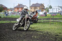 Motorcyclists on motorcycles participate in cross-country race. Royalty Free Stock Image