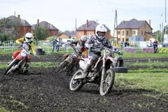 Motorcyclists on motorcycles participate in cross-country race. Royalty Free Stock Photo
