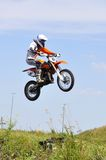 Motorcyclists on motorcycles participate in cross-country race. Royalty Free Stock Photos