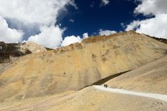 Motorcyclists on the mountain road in the Himalaya, Tibet region in Jammu and Kashmir Royalty Free Stock Images