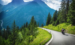Motorcyclists in mountainous touring. Extreme adventure, European journey, extreme road along Alps, active holiday concept Stock Image