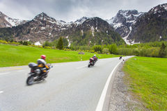 Motorcyclists ride the Maloja pass. Alps, Switzerland Stock Images