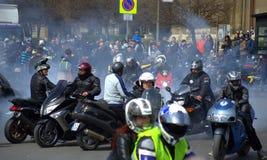 Motorcyclists worming up motors Stock Photos