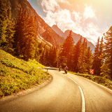 Motorcyclists on the road in sunset Royalty Free Stock Images