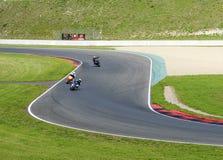 Motorcyclists in steep bend. Motoarena in Germany Stock Photo