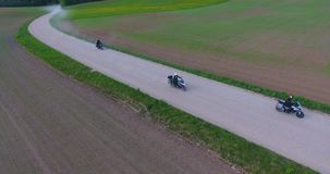 Motorcyclists touring Lithuania passes by on an enduro road bike stock footage