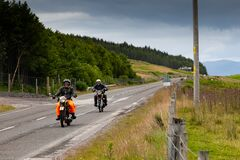 Motorcyclists touring on vintage motorbikes