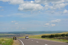 Motorcyclists tourists on the road in the steppes of Khakassia. stock images