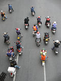 Motorcyclists Wait at a Junction. During rush hour on Sept 10, 2012 in Bangkok, Thailand. Motorcycles are often the transport of choice for Bangkok's heavily stock photography