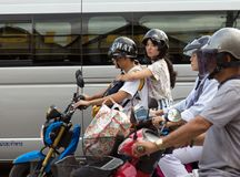 Motorcyclists wait at a junction in Chiang Mai, royalty free stock photography