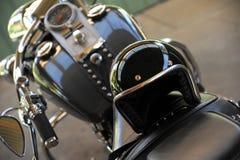 Motorcykel och hjälm Arkivbild