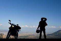 Motorcykellopp och förbluffalandskap arkivfoton