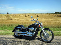 Motorcyle near hay field Stock Photo