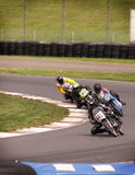 Motorcyle Race. Motorcycle race with riders leaning into turn royalty free stock photo
