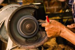 Motore della macina per lavoro segreto, immagine stock